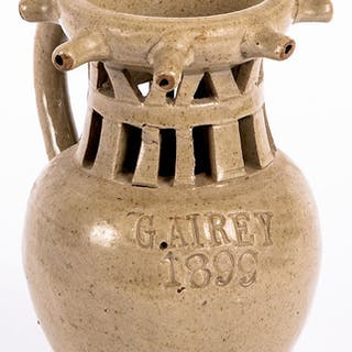 English stoneware or pottery puzzle jug