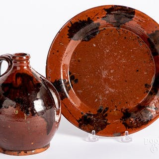 Redware ovoid jug and plate