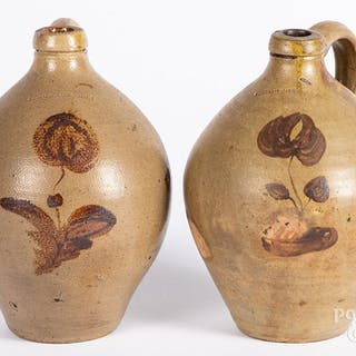 Two similar stoneware jugs