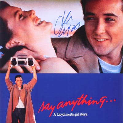 "John Cusack Signed ""Say Anything..."" 11x17 Photo Inscribed ""Llyod"""
