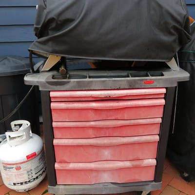 Richman gas grill and Rubbermaid five drawer storage cart
