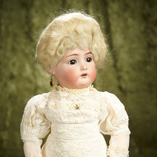"18"" German bisque doll, model 403, by Kammer and Reinhardt. $400/600"