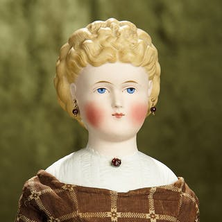 "18"" German bisque doll with blonde sculpted hair and sculpted bodice. $400/600"