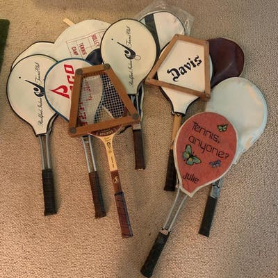 Group of seven vintage tennis rackets and covers