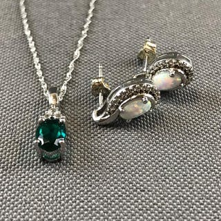 18 inch 10k white gold rope chain with emerald and white sapphire
