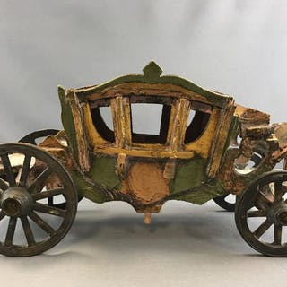 Vintage wooden carriage with moving metal wheels