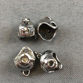 Group of 4 Sterling Silver helmet pendants
