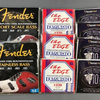 Group of 9 Guitar strings in packaging