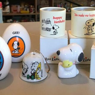 Group of Peanuts candles, figurines, and more