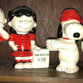 Group of 4 Hallmark Peanuts Candle holders