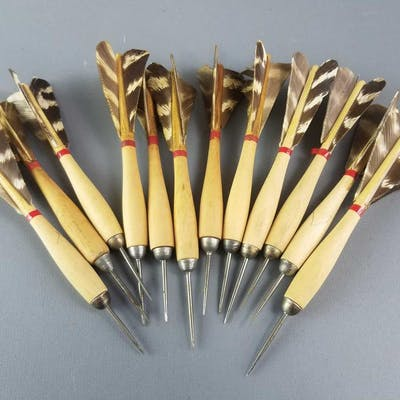 Group of a dozen vintage throwing darts.