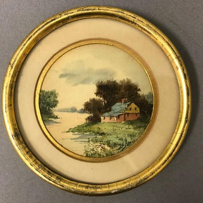 Vintage framed round artwork of house and stream