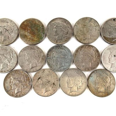 Group of 14 peace silver dollars