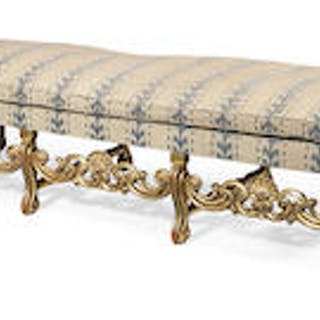 A giltwood long stool in the Queen Anne style