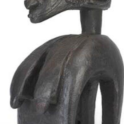 Shoulder mask of carved black patinated wood. Baga style. H. 85 cm.