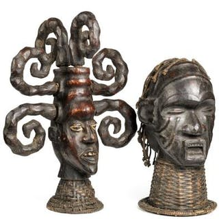 Two masks of carved wood covered with animal hide and braid