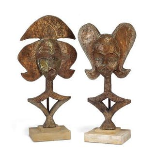 Two guardian figures of carved patinated wood mounted...