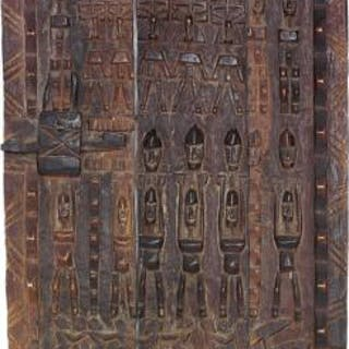 Two small doors of carved patinated wood. Dogon style. H. 60 and 63 cm. (2)