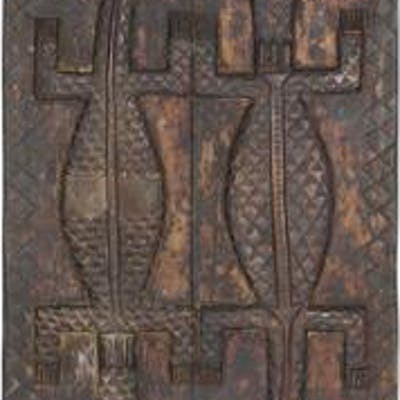 Two larger doors of carved patinated wood