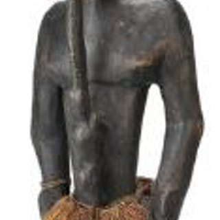 Ancestor figure of carved patinated wood mounted with shells and raffia