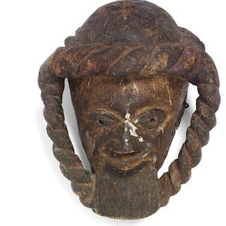 Gelede mask of carved patinated wood with traces of white pigment