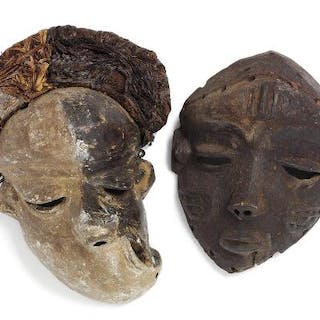 Two Pende masks of carved patinated wood