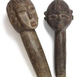 Two heads of carved patinated wood