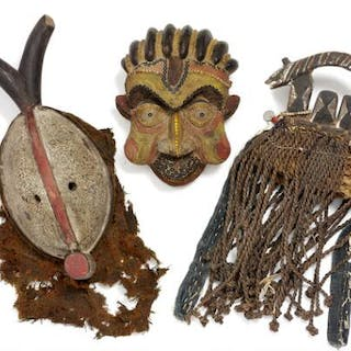Two masks and a headdress of carved patinated wood