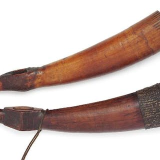 Two trumpets of carved patinated ivory