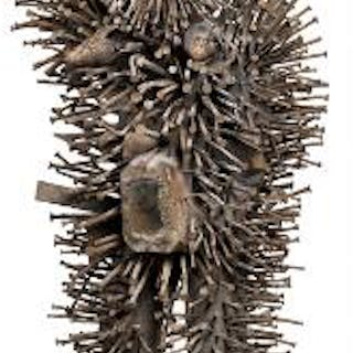 Large nail fetish of carved patinated wood mounted with numerous nails