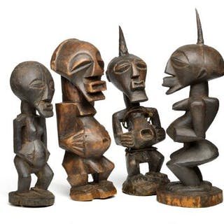 Four fetish figures of carved patinated wood. Songye style. H. 26–35 cm. (4)