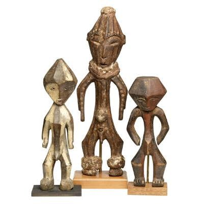 Three ancestor figures of carved patinated wood