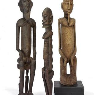 Three ancestor figures of carved patinated wood, Dogon style. H. 79–95 cm. (3)