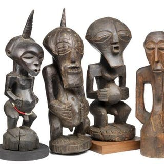 Four fetish figures of carved patinated wood