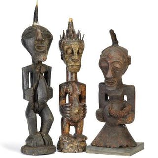 Three large fetish figures of carved patinated wood mounted with horn
