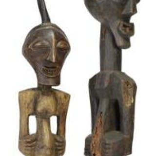 Two large fetish figures of carved patinated wood mounted with horn