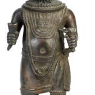 Altar figure of patinated bronze holding horn and sceptre