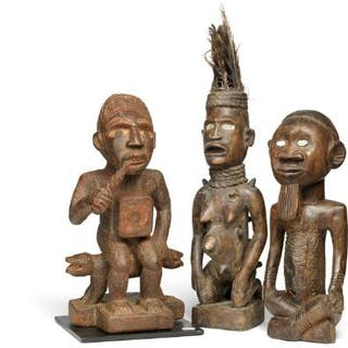 Three ancestor figures of carved patinated wood mounted with shells