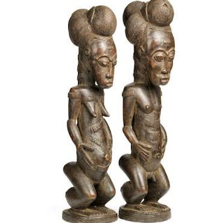 Two ancestor figures of carved patinated wood. Baulé style. H. 48