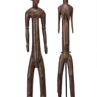 Two ancestor figures of carved patinated wood with traces of red pigment