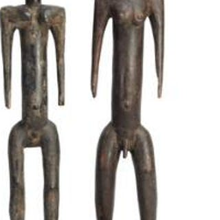 Two ancestor figures of carved patinated wood. Mossi style. H. 74