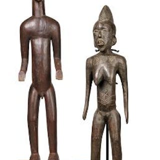 Two ancestor figures of patinated wood decorated with red pigment