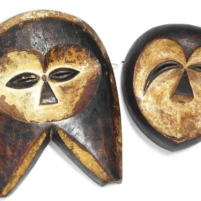 Two masks of carved patinated wood