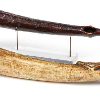 A pair of trumpets of carved patinated ivory