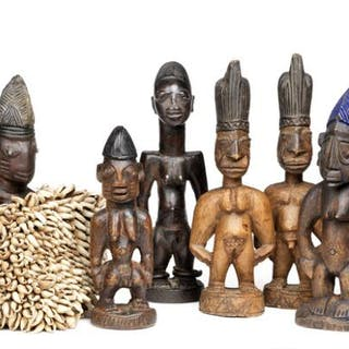 A collection of Ibeji twin figures of carved patinated wood