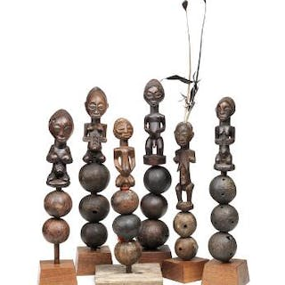 A collection of six rattles with ancestor figures of...