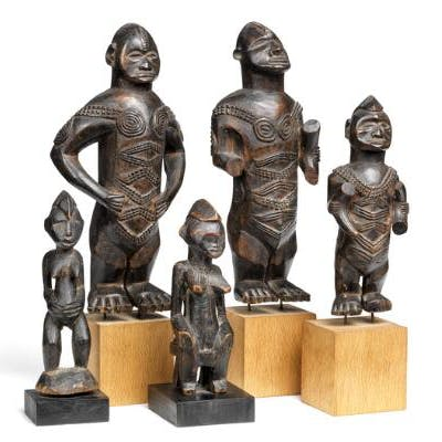 A collection of five ancestor figures of carved patinated wood