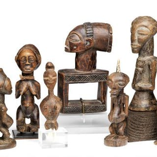 A collection of seven small ancestor figures of carved patinated wood