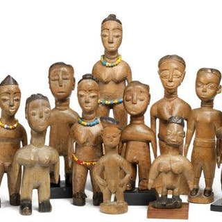 A figure collection of light patinated wood. Ewe, Benin. H. 16–24 cm. (11)