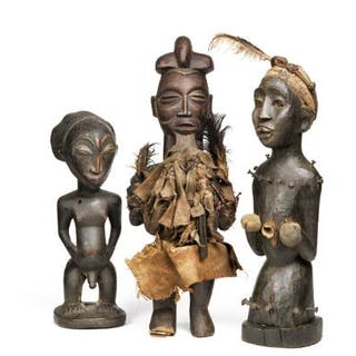 A collection of three ancestor figures of carved...